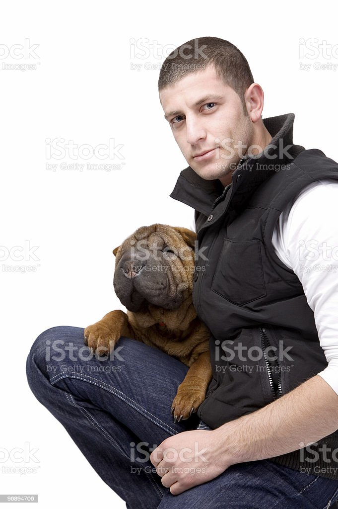 Young man with his dog royalty-free stock photo