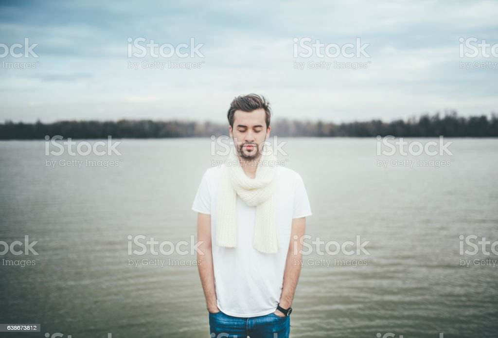 Young man with his eyes closed stock photo