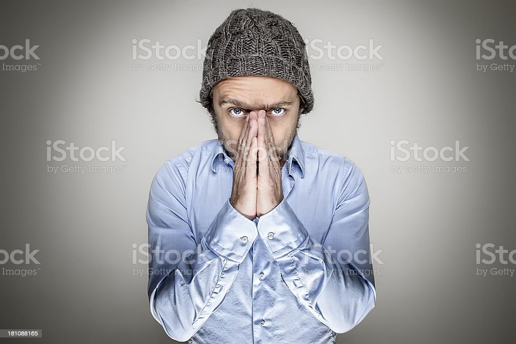 Young man with his hands folded, praying royalty-free stock photo