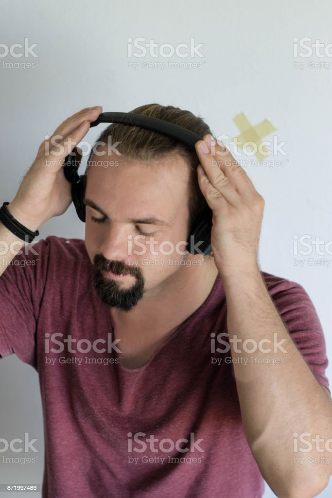 Young man with his headphones on stock photo