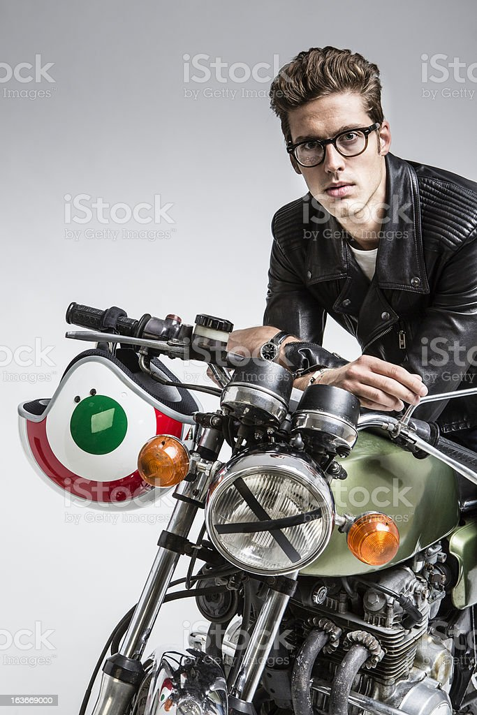 Young man with his motorcycle royalty-free stock photo