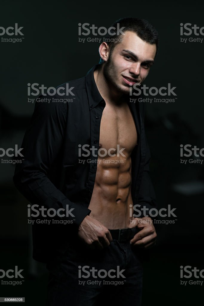 Young Man With His Shirt Open stock photo