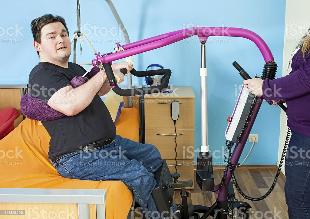 Young man with infantile cerebral palsy. stock photo