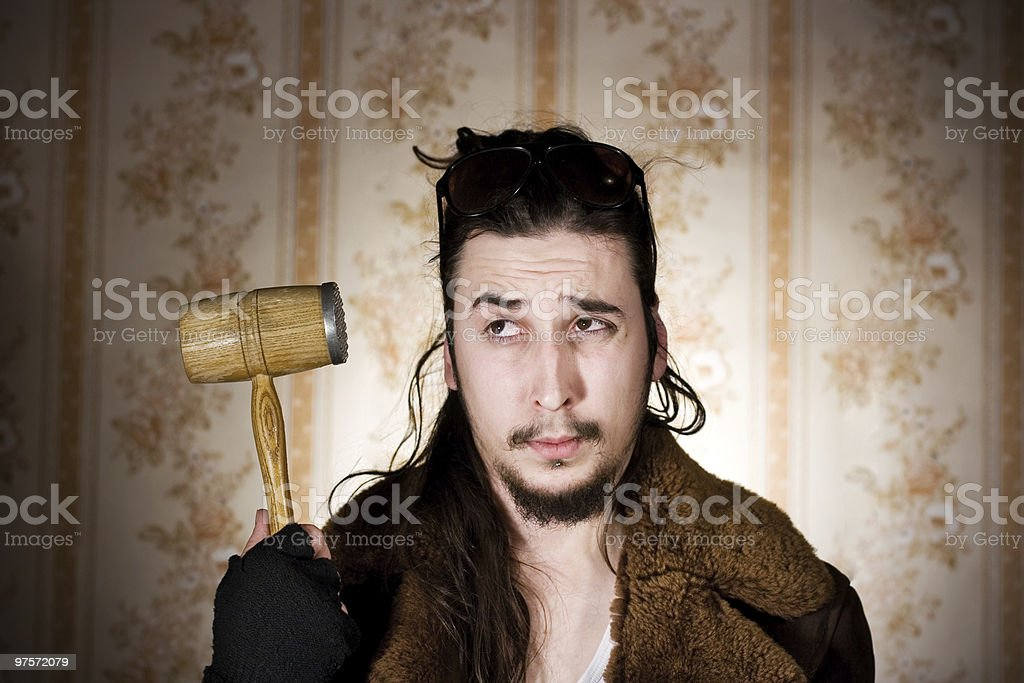 Young man with kitchen mallet royalty-free stock photo