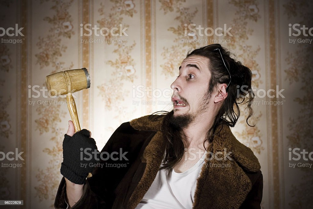 Young man with kithen mallet royalty-free stock photo