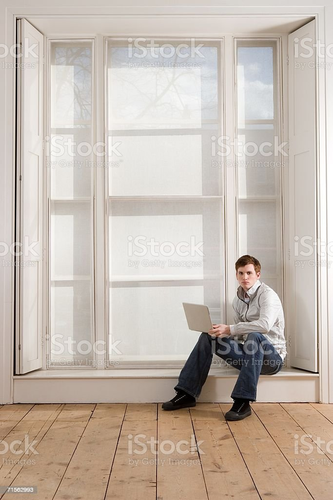Young man with laptop royalty-free stock photo