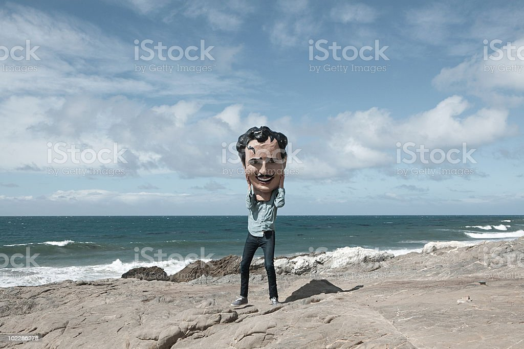 Young man with large head obscuring face stock photo