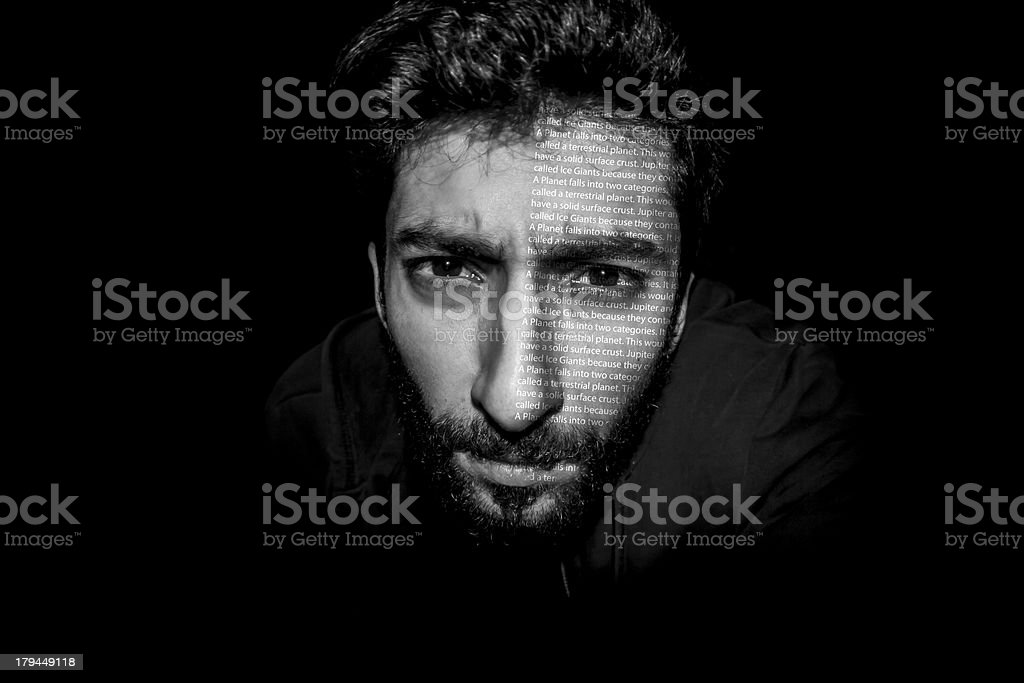 Young Man with Letters printed over his face royalty-free stock photo