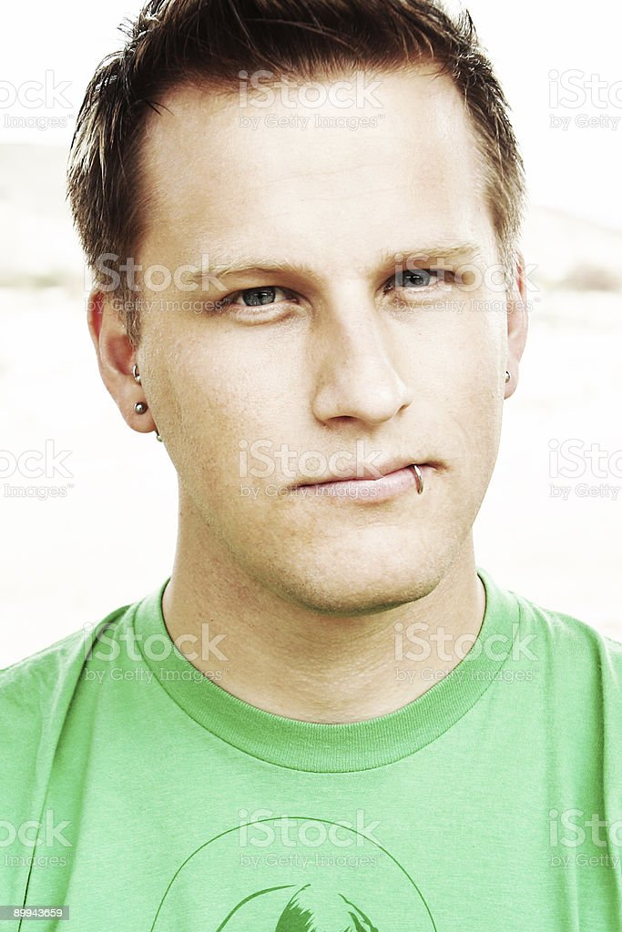 Young Man with Lip Ring and Green Shirt royalty-free stock photo