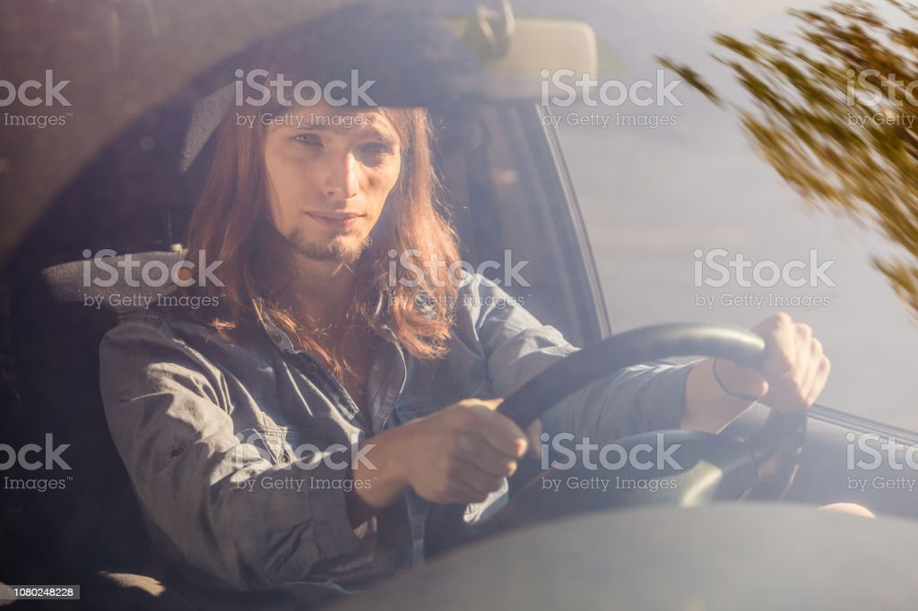 Young Man With Long Hair Driving Car Stock Photo Download Image Now Istock
