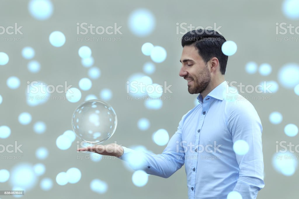 Young man with magical glowing spheres stock photo