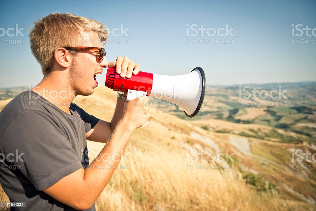 Young man with megaphone royalty-free stock photo