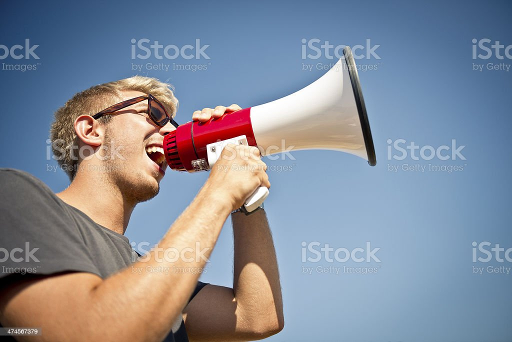 Young man with megaphone stock photo