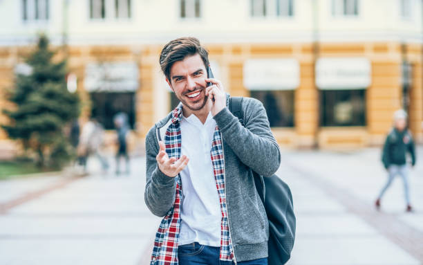 young man with mobile phone in the city - violetastoimenova stock photos and pictures
