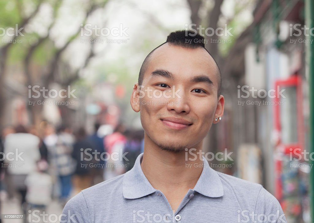 Young Man With Mohawk Haircut Smiling Looking At Camera Stock Photo