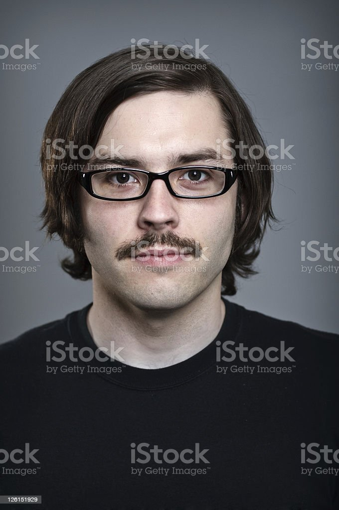 Young man with mustache and thick glasses royalty-free stock photo