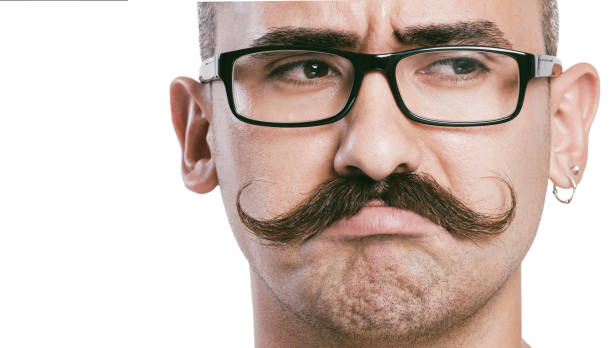 Young man with mustache close up Young male with glasses and mustache, white background, studio shot, close up mustache stock pictures, royalty-free photos & images
