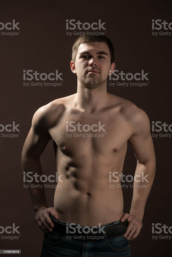 Young man with naked torso stock photo