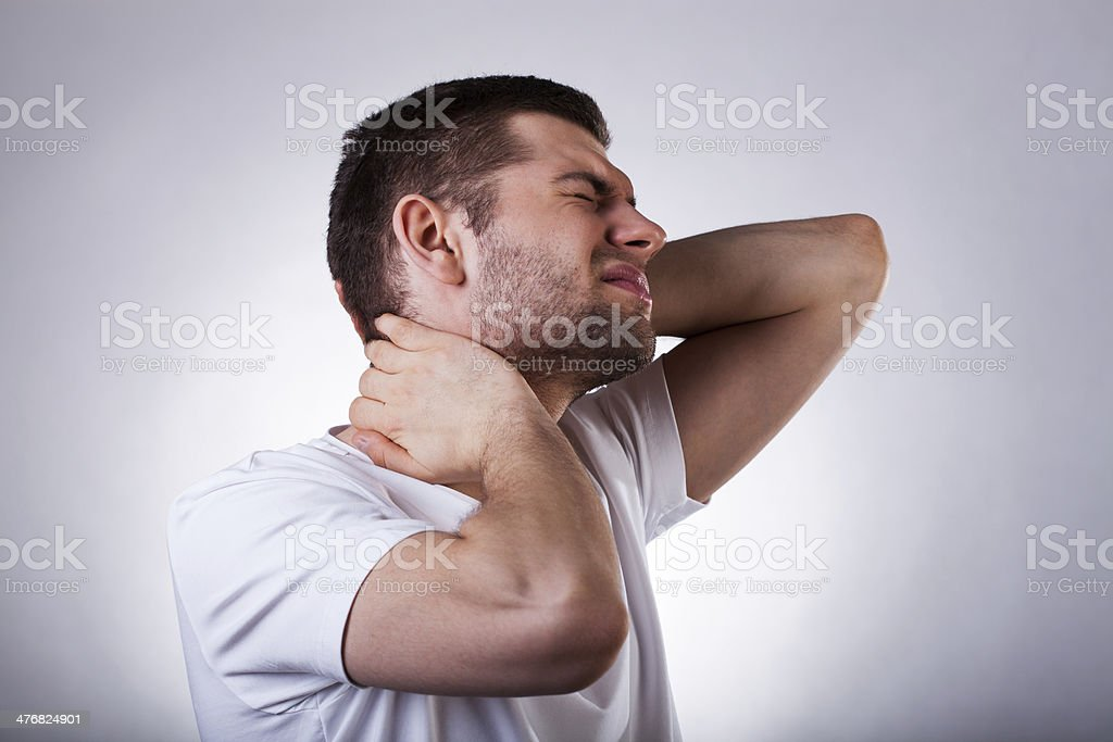 Young man with neck ache royalty-free stock photo