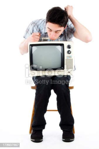 young man fixing old tv.studio shot.