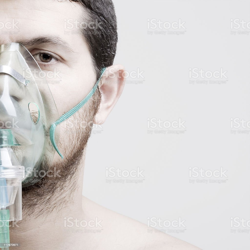 Young man with oxygen mask stock photo