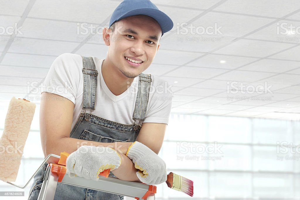 Young man with painting equipment stock photo