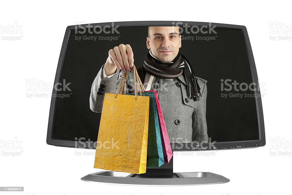 young man with paper bags in a computer monitor royalty-free stock photo