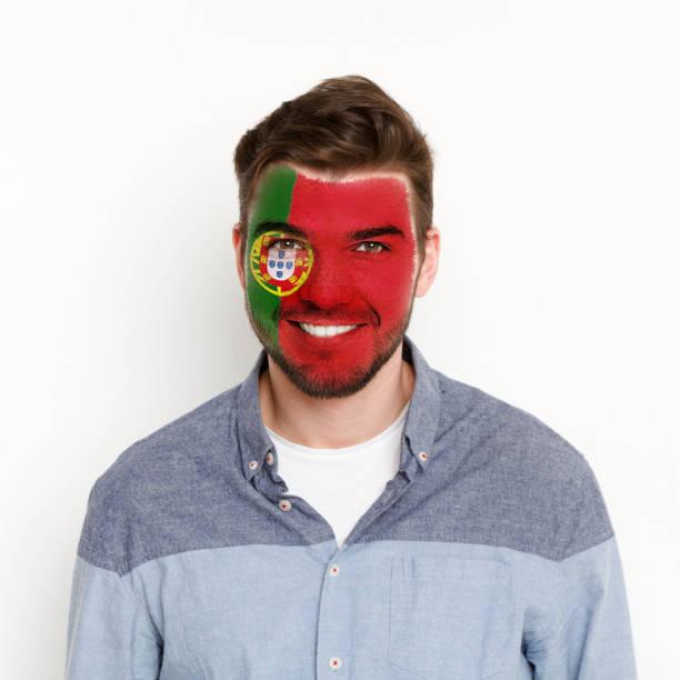 ung man med portugal flagga målad på hans ansikte - football portugal flag bildbanksfoton och bilder