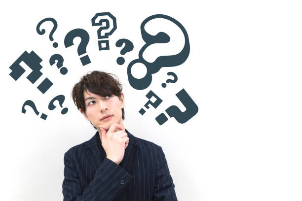 young man with question marks. stock photo