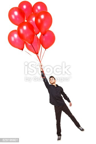 Young man with red balloons isolated on white background.