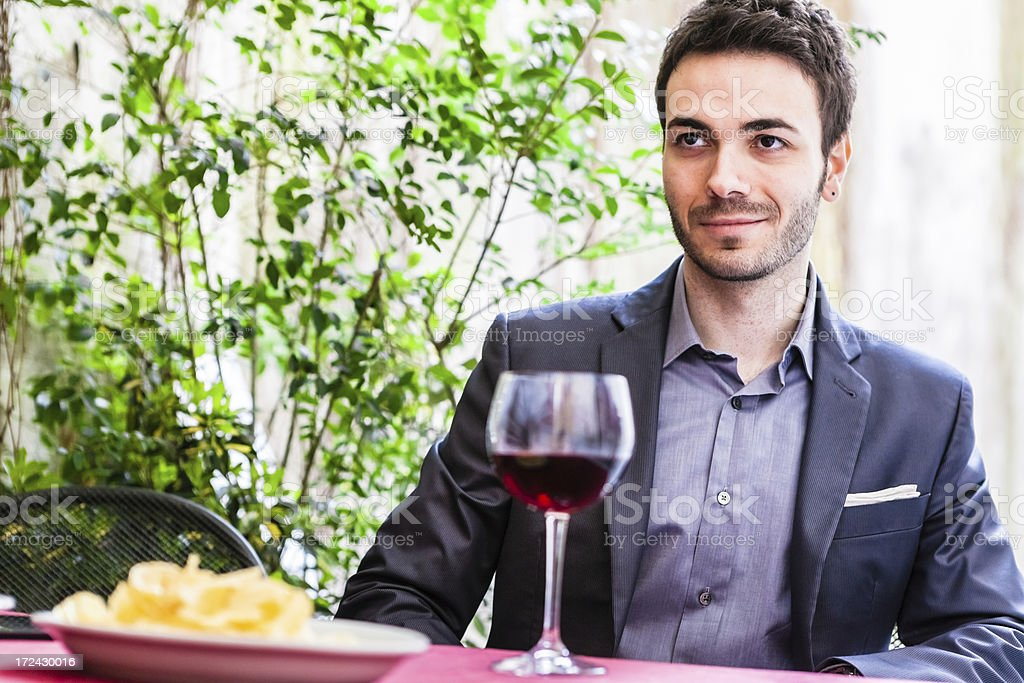 Young Man with Red Wine at the Table royalty-free stock photo