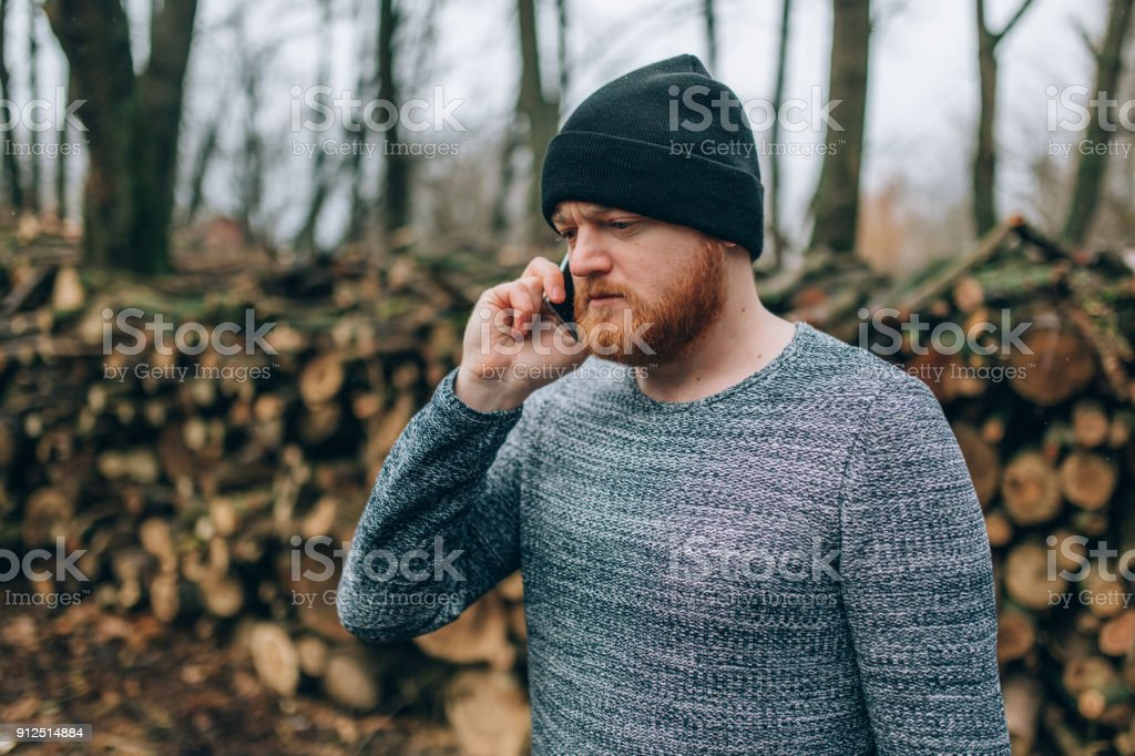 21883bf3024 Young Man With Redhead Beard And Cap Stock Photo   More Pictures of ...