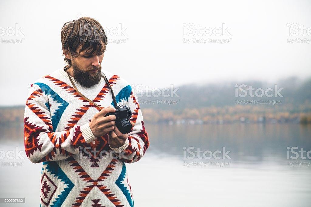 Young Man with retro photo camera Fashion Travel Lifestyle stock photo