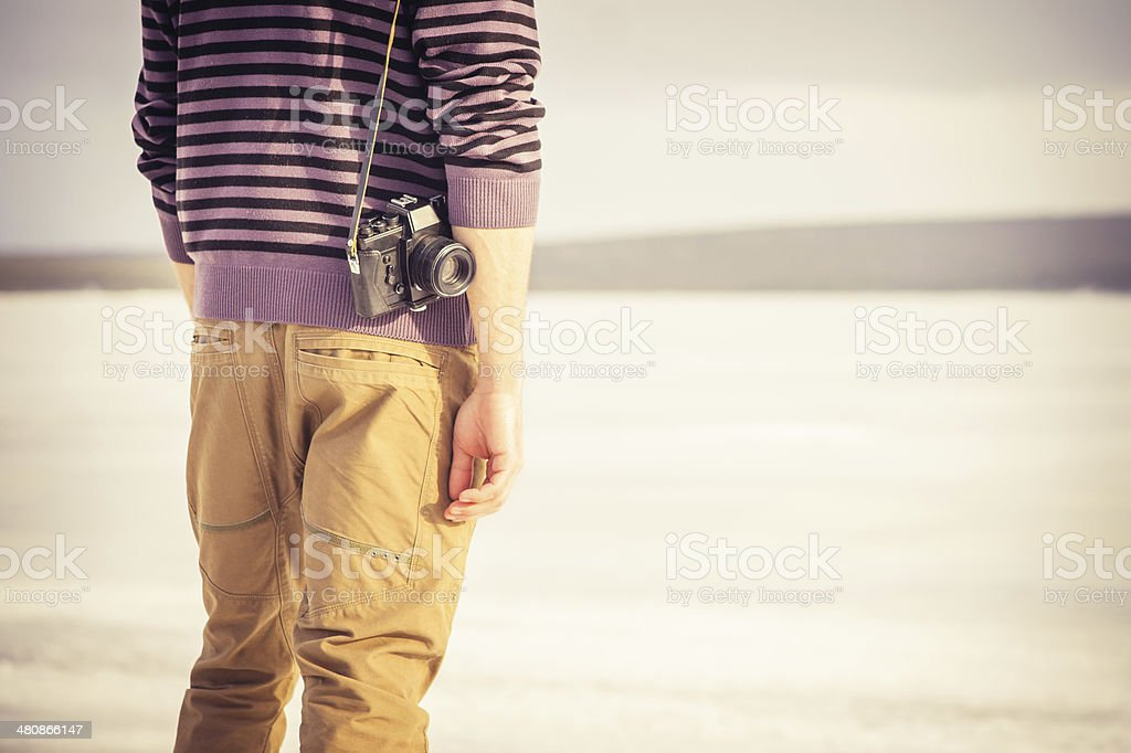 Young Man with retro photo camera outdoor royalty-free stock photo