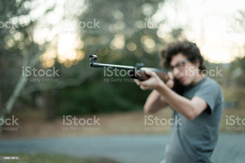 Young man with rifle stock photo