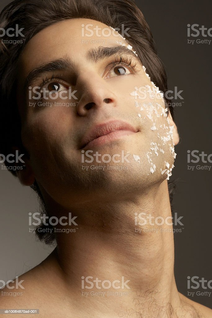 Young man with rock salt on face 免版稅 stock photo
