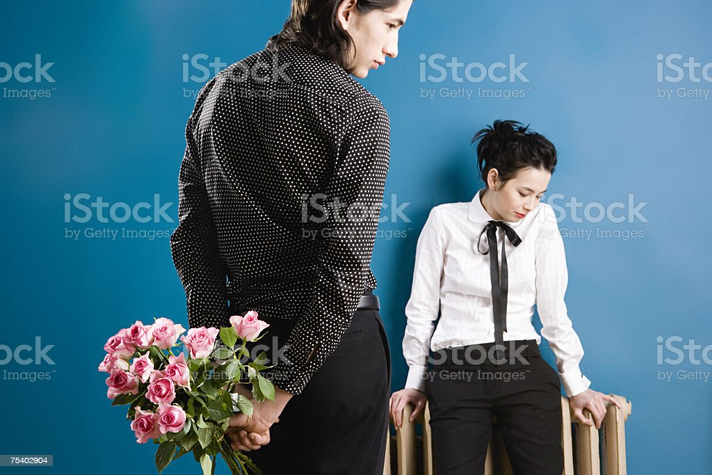 Young man with roses for young woman royalty-free stock photo