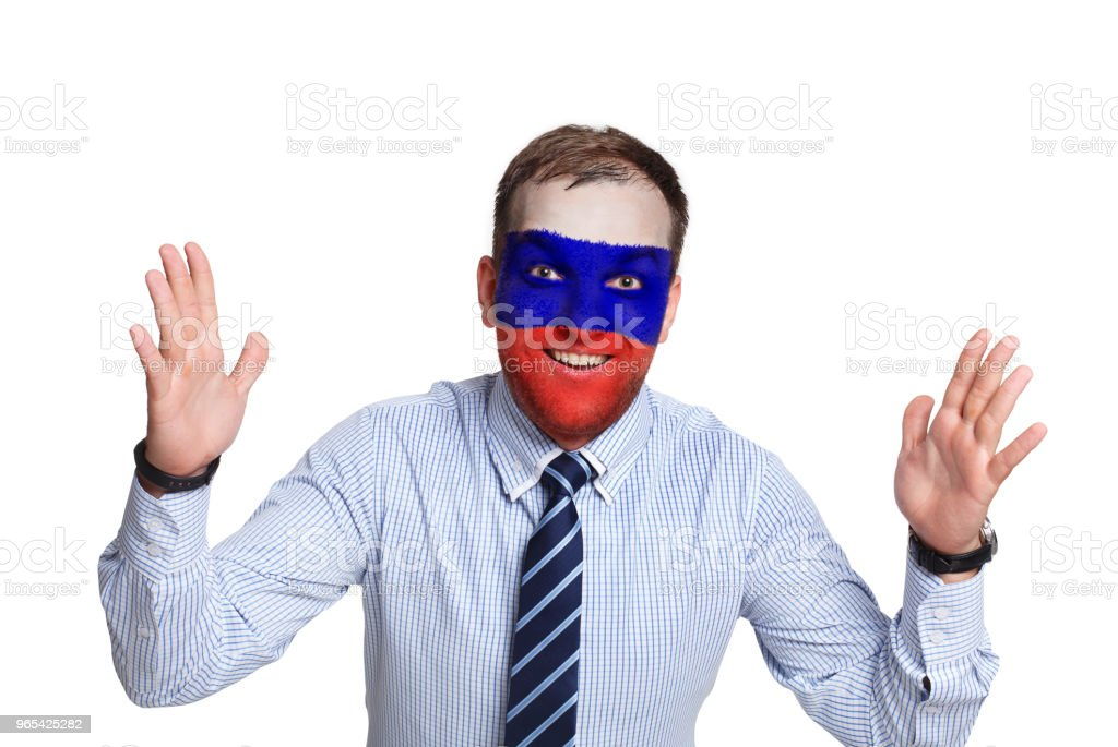 Young man with Russia flag painted on his face zbiór zdjęć royalty-free