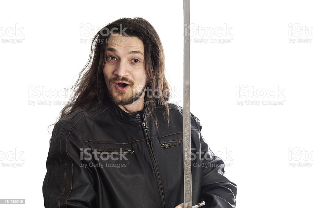 Young man with silly expression and sword. stock photo