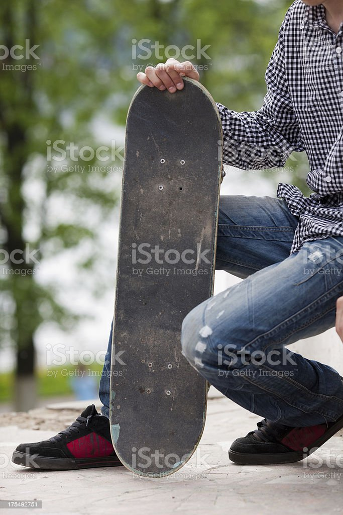 Young man with skateboard royalty-free stock photo