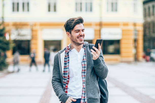 young man with smart phone in the city - violetastoimenova stock photos and pictures