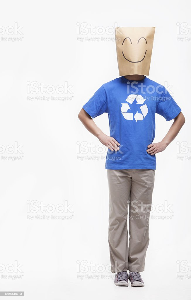 Young man with smiley face paper bag over his head stock photo