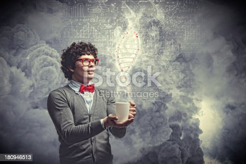 istock Young man with smoke coming out of cup 180946513
