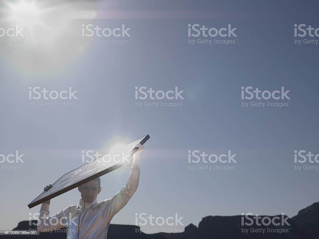 Young man with solar panel, portrait royalty-free stock photo