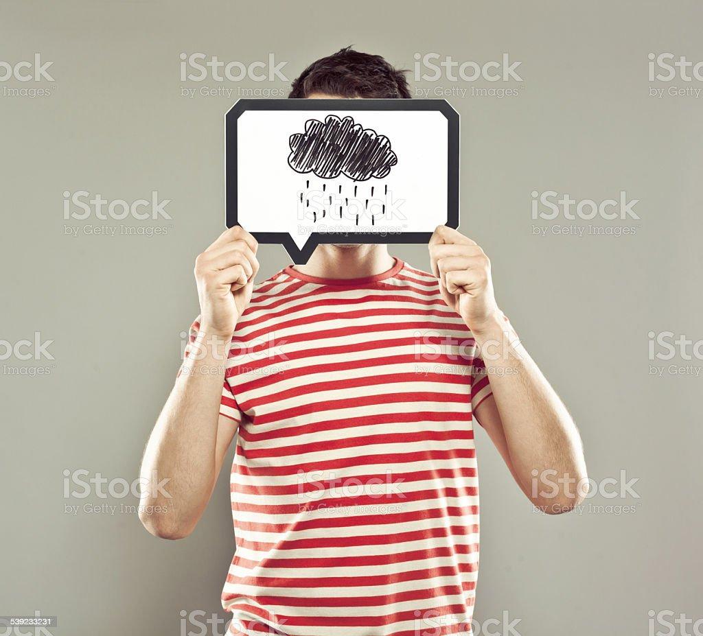 Hombre joven con burbujas de discurso sobre su rostro foto de stock libre de derechos