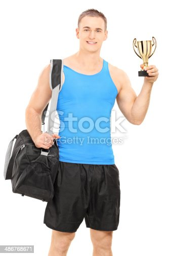 istock Young man with sports bag and a trophy 486768671