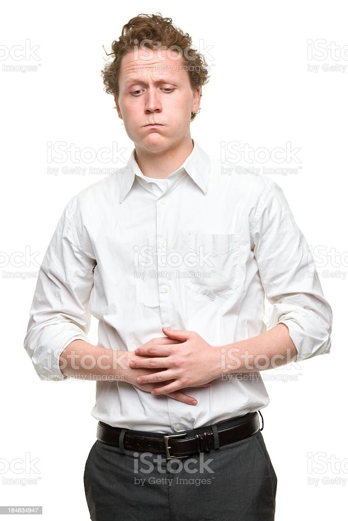 Young Man With Stomach Problems stock photo