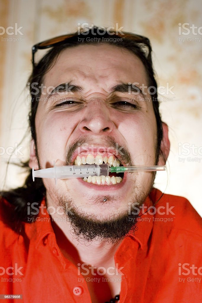 Young man with syringe royalty-free stock photo