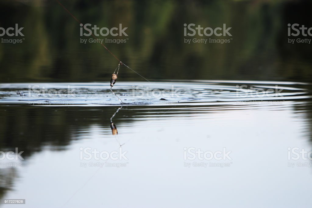 Young man with tent while fishing stock photo