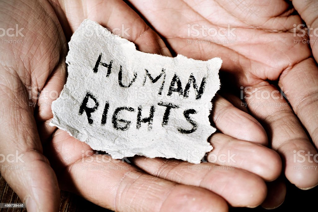 young man  with the text human rights stock photo